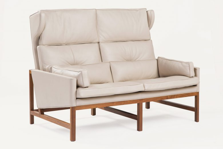 BassamFellows CB-522 Wing Back Settee with exposed solid Walnut frame, credit ELDON Zimmerman